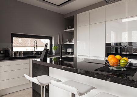 black granite countertop with white cabinets